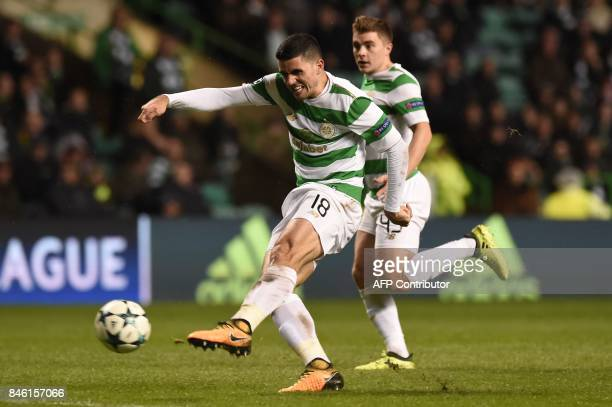 Celtic's Australian midfielder Tom Rogic has an unsuccessful shot during the UEFA Champions League Group B football match between Celtic and Paris...