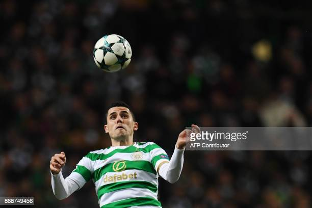 Celtic's Australian midfielder Tom Rogic heads the ball during the UEFA Champions League Group B football match between Celtic and Bayern Munich at...