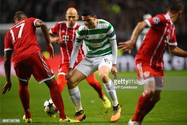 Celtic's Australian midfielder Tom Rogic is blocked by Bayern Munich's German defender Jerome Boateng during the UEFA Champions League Group B...