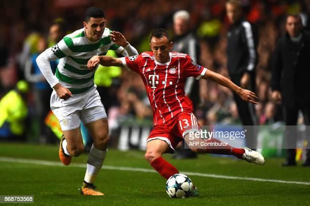 Celtic's Australian midfielder Tom Rogic vies with Bayern Munich's Brazilian defender Rafinha during the UEFA Champions League Group B football match...