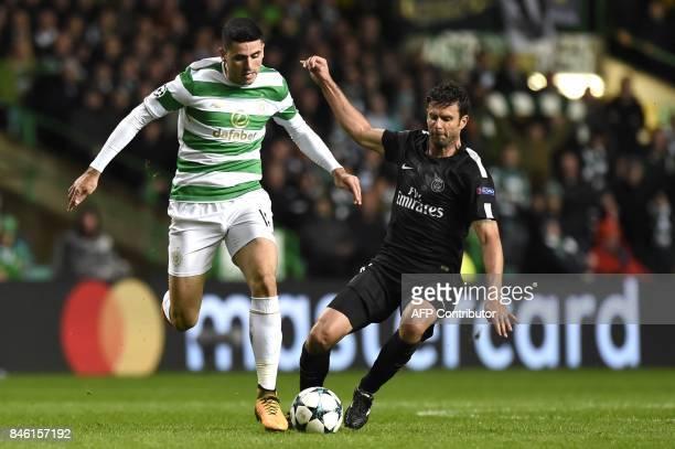 Celtic's Australian midfielder Tom Rogic vies with Paris SaintGermain's Italian midfielder Thiago Motta during the UEFA Champions League Group B...