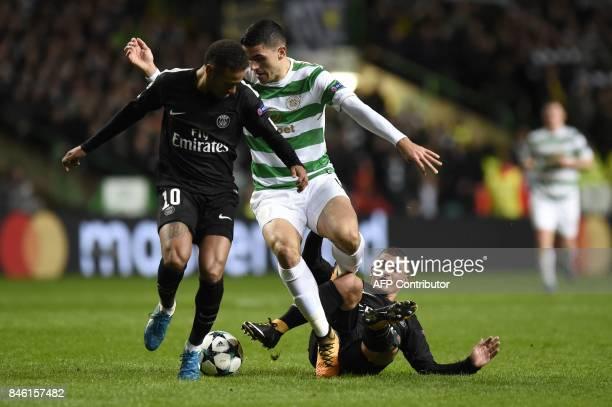 Celtic's Australian midfielder Tom Rogic vies with Paris SaintGermain's Brazilian striker Neymar and Paris SaintGermain's Italian midfielder Marco...
