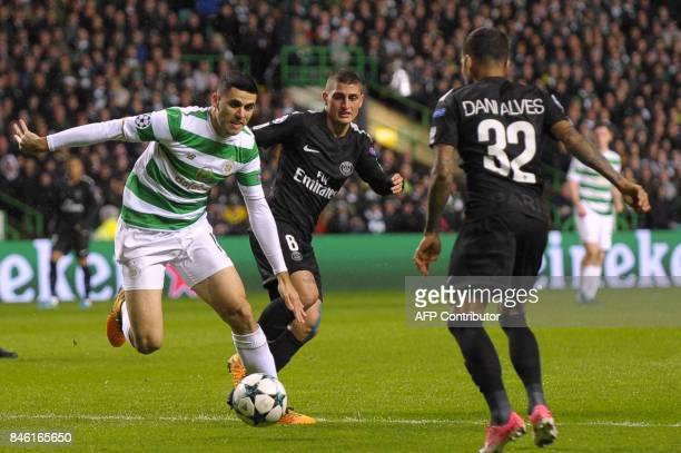 Celtic's Australian midfielder Tom Rogic vies with Paris SaintGermain's Italian midfielder Marco Verratti and Paris SaintGermain's Brazilian defender...