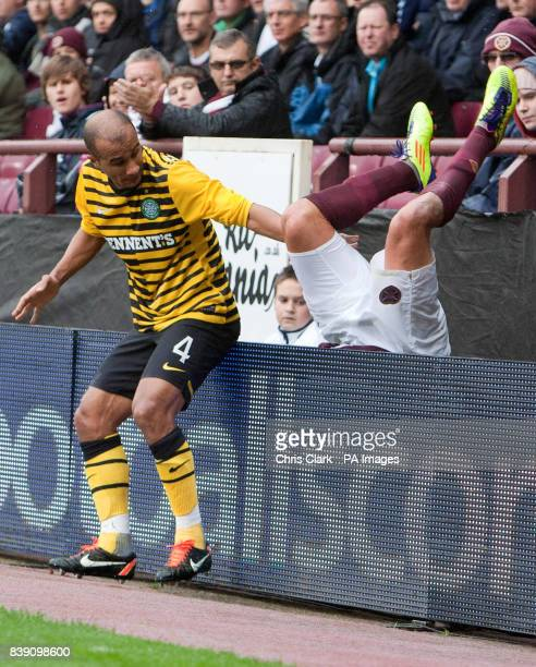 Celtic's Badr El Kaddouri watches as Heart of Midlothian's Rudi Skacel falls over the advertising boards during the Clydesdale Bank Scottish Premier...