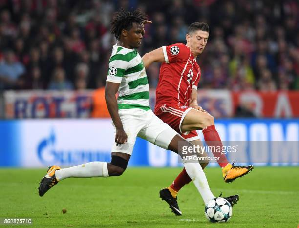 Celtic's Belgian defender Dedryck Boyata and Bayern Munich's Polish striker Robert Lewandowski vie for the ball during the Champions League group B...