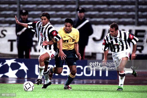 Celtic's Bobby Petta tries to force his way past Juventus' Alessio Tacchinardi and Alessandro Birindelli