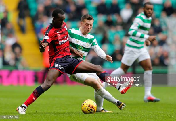 Celtic's Callum McGregor and Dundee's Glen Kamara battle for the ball during the Ladbrokes Scottish Premiership match at Celtic Park Glasgow