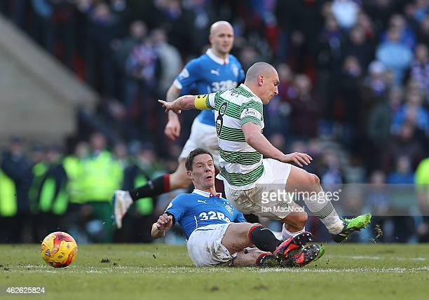 /Celtic's captain Scott Brownis tackled by Rangers Ian Black during the Scottish League Cup SemiFinal football match between Celtic and Rangers at...