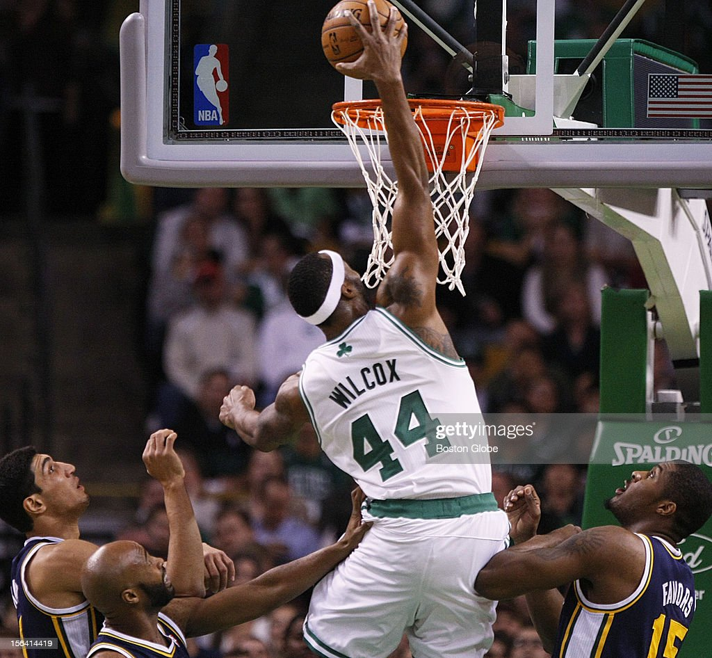 Celtics center Chris Wilcox (#44) puts back a slam after a layup miss by Leandro Barbosa (#12) in the first quarter as the Boston Celtics play the Utah Jazz at TD Garden in a regular season NBA game in Boston, Mass. on Wednesday, Nov. 14, 2012.