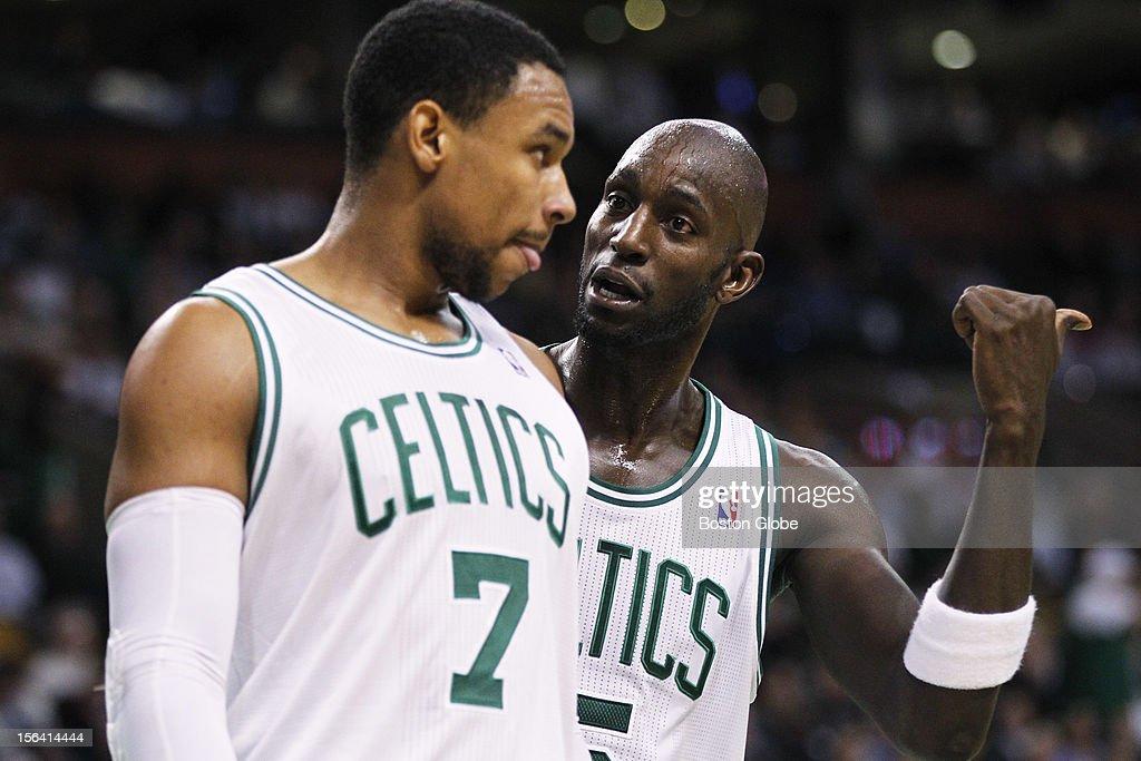 Celtics center Kevin Garnett (#5) talks to rookie forward Jared Sullinger (#7) in the fourth quarter as the Boston Celtics play the Utah Jazz at TD Garden in a regular season NBA game in Boston, Mass. on Wednesday, Nov. 14, 2012.