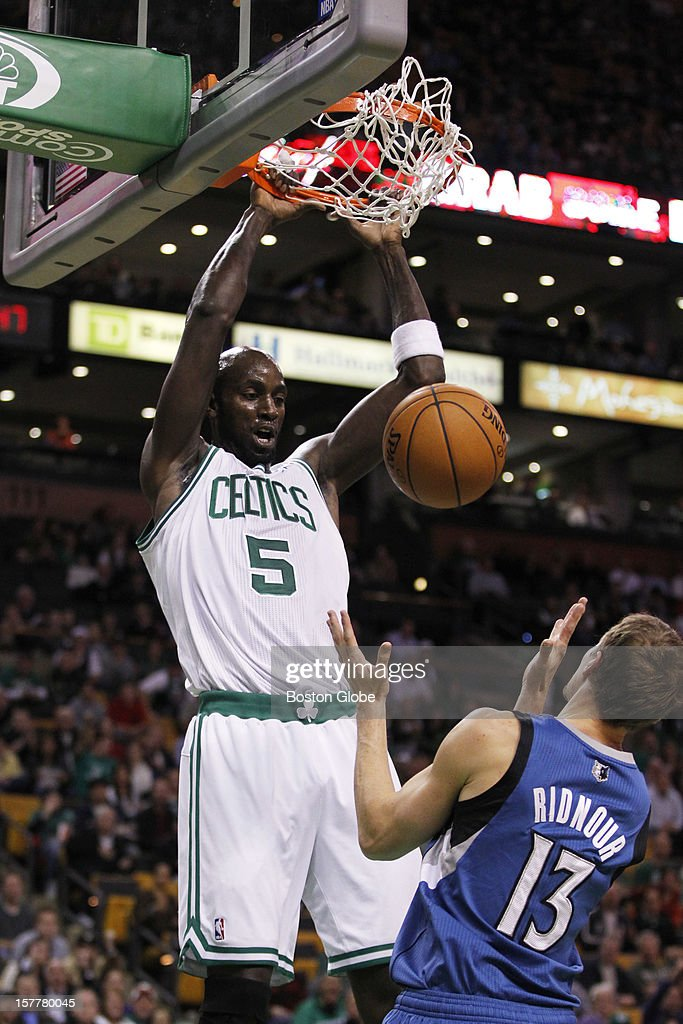 Celtics center-forward Kevin Garnett (#5) dunks on an alley-oop pass from guard Rajon Rondo (#9) in the first quarter as the Boston Celtics play the Minnesota Timberwolves during a regular season NBA game at the TD Garden in Boston, Mass. on Wednesday, Dec. 5, 2012. Timberwolves guard Luke Ridnour #13 is at right.