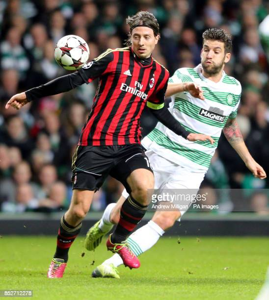 Celtic's Charlie Mulgrew challenges AC Milan's Riccardo Montolivo during the UEFA Champions League match at Celtic Park Glasgow