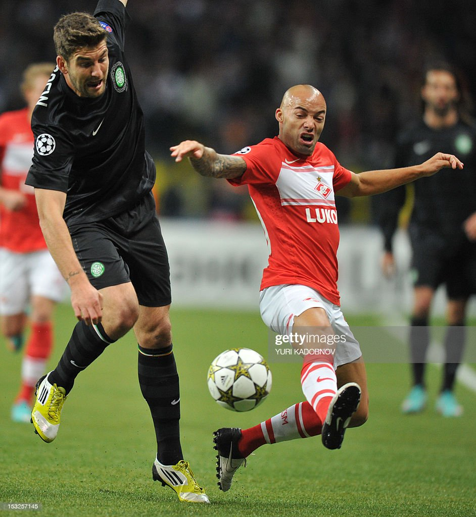 Celtic's Charlie Mulgrew (L) vies for the ball with Demy de Zeeuw (R) of Spartak Moskva during their UEFA Champions League group G football match at the Luzhniki stadium in Moscow on October 2, 2012.