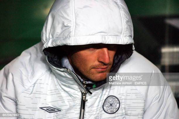 Celtic's Chris Sutton watches the match from the bench
