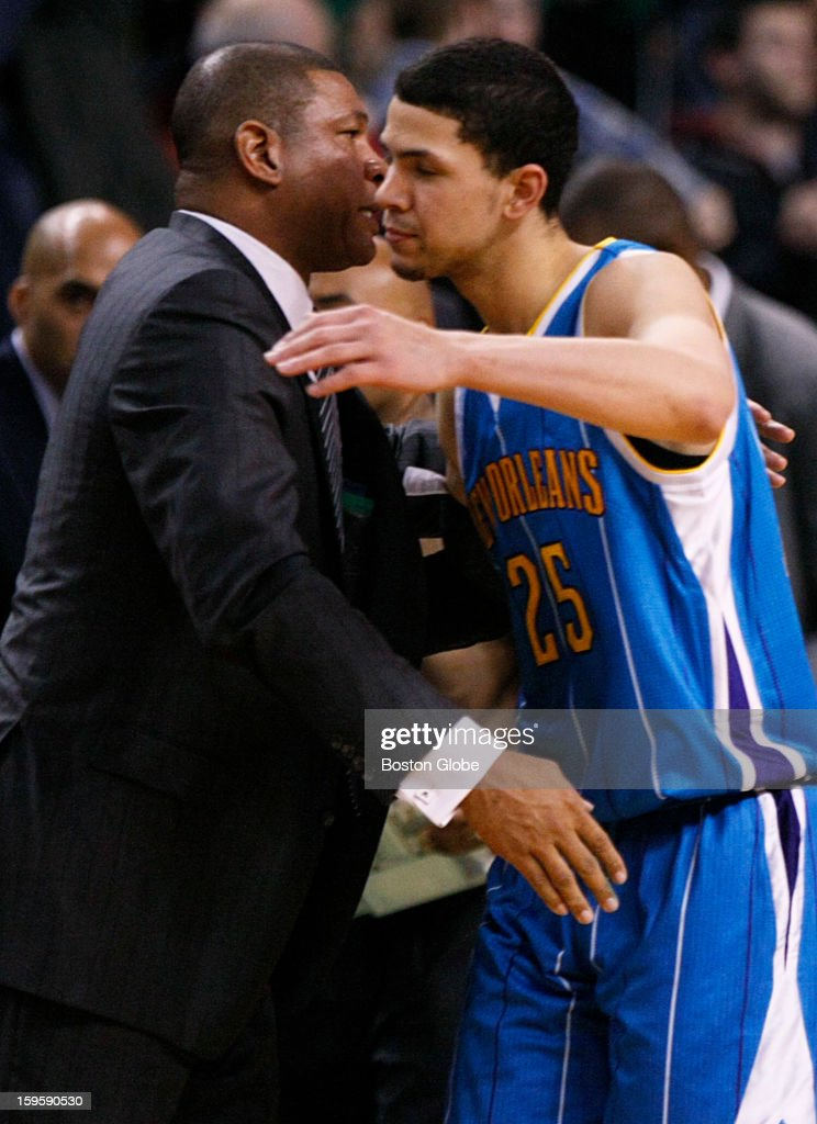 Celtics coach Doc Rivers and his son, Hornets guard Austin Rivers (#25), hug after the game as the Boston Celtics played the New Orleans Hornets in a regular season NBA game at TD Garden in Boston, Mass. on Wednesday, Jan. 16, 2013.