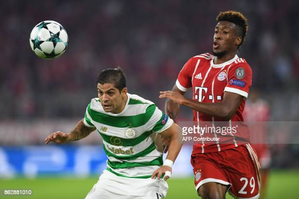 Celtic's Costa Rican defender Cristian Gamboa and Bayern Munich's French defender Kingsley Coman vie for the ball during the Champions League group B...
