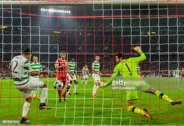Celtic's Costa Rican defender Cristian Gamboa clears the ball during the Champions League group B match between FC Bayern Munich and Celtic Glasgow...