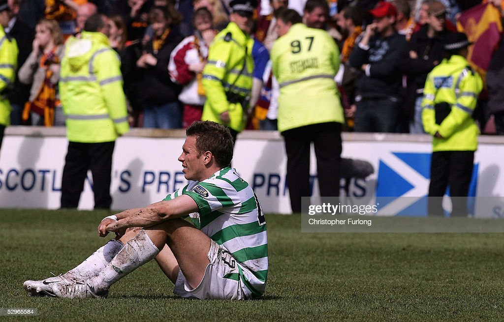 Celtic's Craig Bellamy sits on the pitch dejected after Motherwell scored two goals in the dying minutes denying Celtic the league title during the Scottish Premier League match between Motherwell and Celtic at Fir Park on May 22, 2005, Motherwell, Scotland.