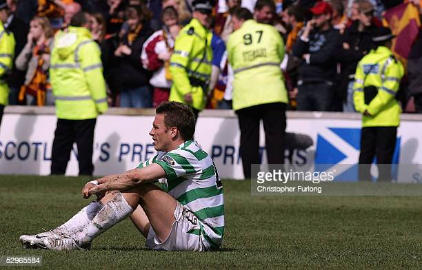 Celtic's Craig Bellamy sits on the pitch dejected after Motherwell scored two goals in the dying minutes denying Celtic the league title during the...