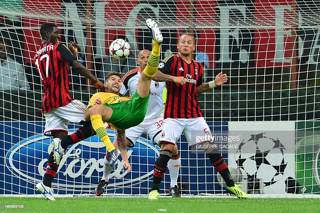 Celtic's defender Charlie Mulgrew (C) makes a bicycle kick between AC Milan's Colombian defender Cristian Zapata (L) and AC Milan's French defender Philippe Mexes (R) during the Champions League football match AC Milan vs Celtic Glagow on September 18, 2013 at San Siro Stadium in Milan. AFP PHOTO / GIUSEPPE CACACE