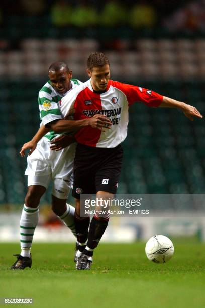 Celtic's Didier Agathe and Feyenoord's Patrick Paauwe battle for the ball