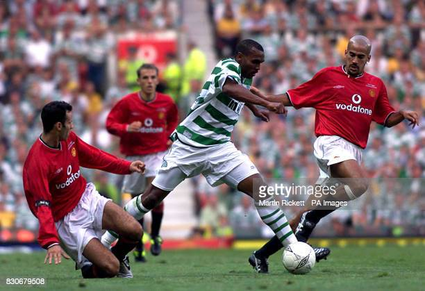 LEAGUE Celtics' Didier Agathe skips past a challenge from Manchester United's Ryan Giggs watched by Juan Veron during the Ryan Giggs Testimonial game...