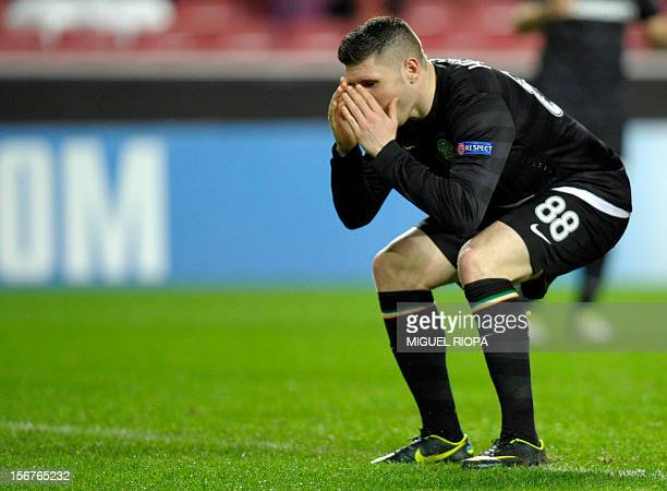 Celtic's English striker Gary Hooper reacts after missing an opportunity to score a goal against Benfica during the UEFA Champions League football...