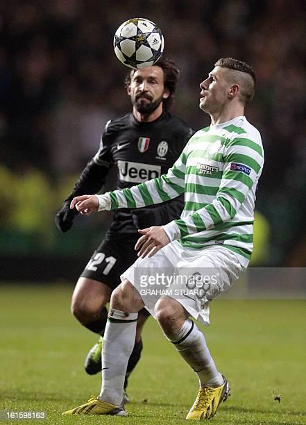 Celtic's English striker Gary Hooper vies with Juventus's Italian midfielder Andrea Pirlo during the UEFA Champions League last sixteen football...