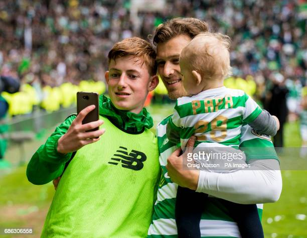 Celtic's Erik Sviatchenko with a ballboy after the trophy presentation at the Ladbrokes Scottish Premiership match at Celtic Park Glasgow