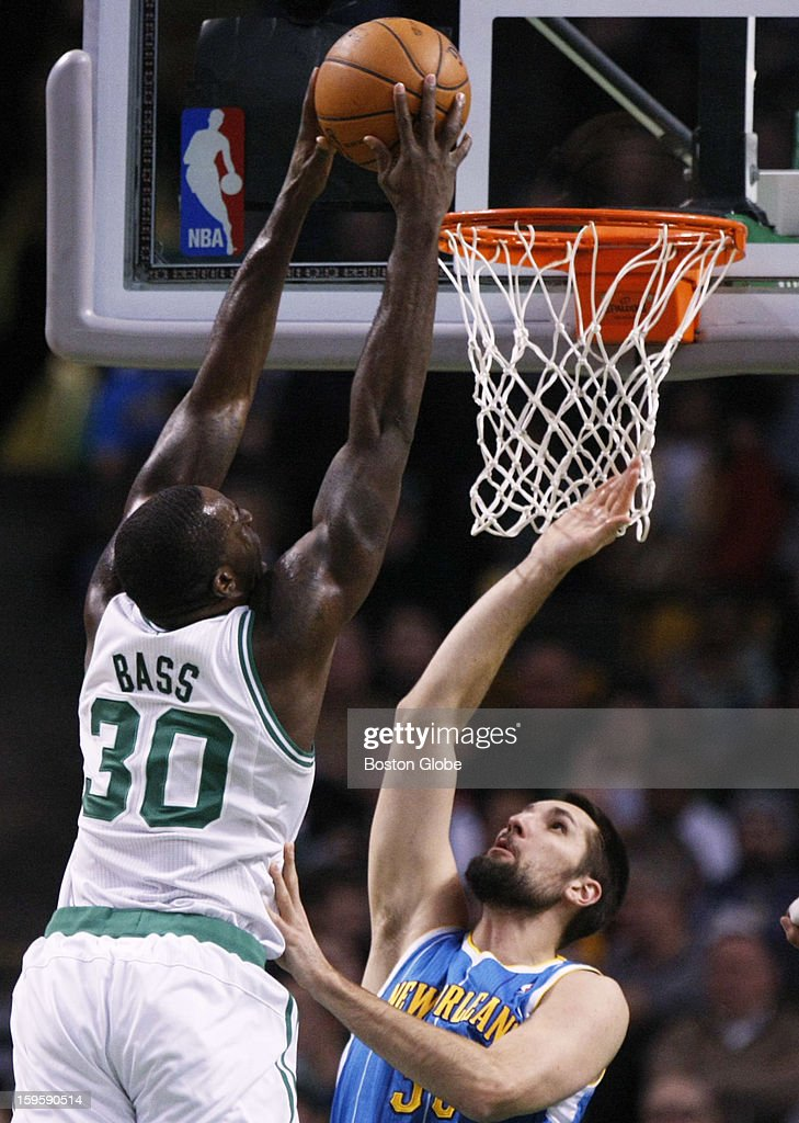 Celtics forward Brandon Bass (#30) dunks on Hornets forward Ryan Anderson (#33) in the first quarter as the Boston Celtics play the New Orleans Hornets in a regular season NBA game at TD Garden in Boston, Mass. on Wednesday, Jan. 16, 2013.