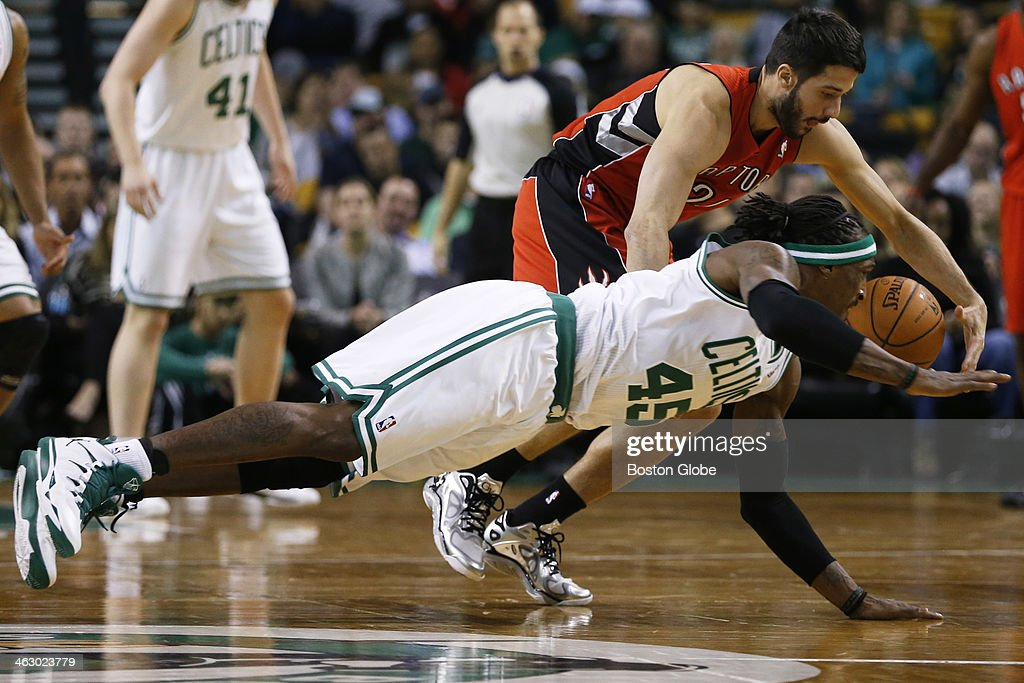 Celtics forward Gerald Wallace (#45) attempted to steal the ball from Raptors point guard Greivis Vasquez (#21) in the second quarter. The Boston Celtics played the Toronto Raptors at the TD Garden during a regular season NBA game in Boston, on Wednesday, Jan. 15, 2014.
