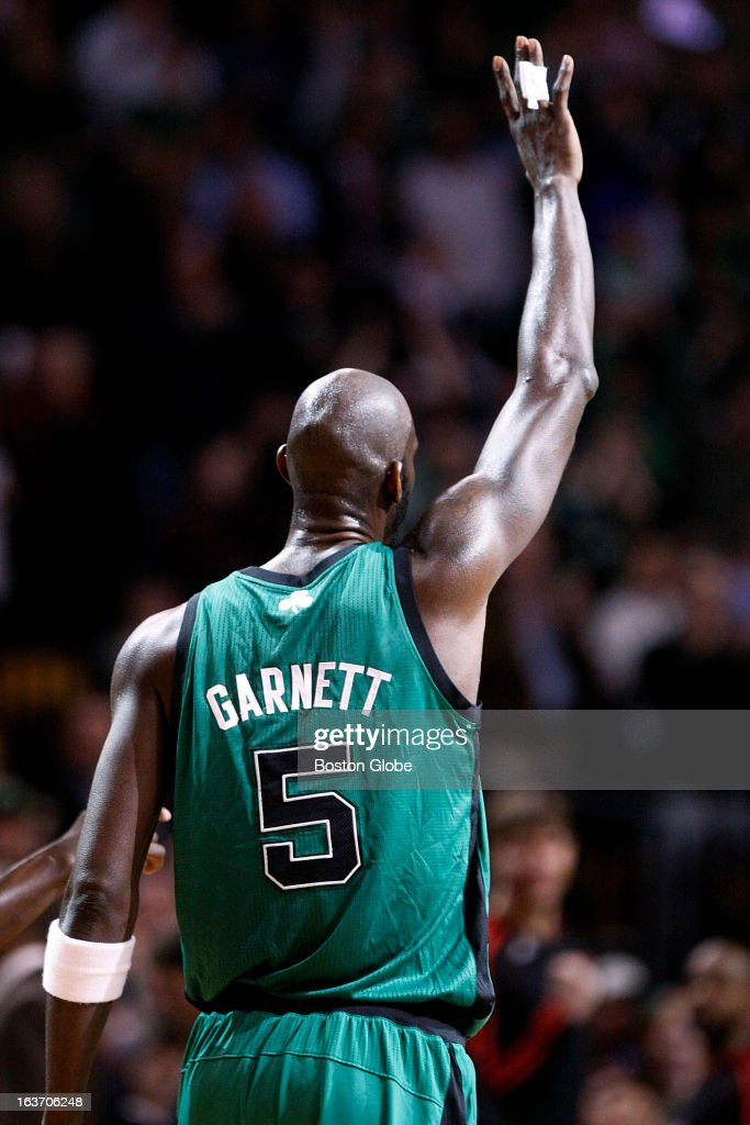 Celtics forward Kevin Garnett (#5) acknowledges the crowd after it is announced that he is the 15th all time scorer in the NBA as the Boston Celtics hosted the Toronto Raptors at the TD Garden during a regular season NBA game in Boston, Mass. on Wednesday, March 13, 2013.