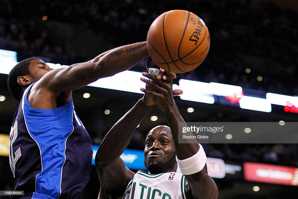 Celtics forward Kevin Garnett (#5) battles for possession of the ball in the first quarter with Mavericks guard O.J. Mayo (#32) as the Boston Celtics play the Dallas Mavericks during a regular season NBA game at TD Garden in Boston, Mass. on Wednesday, December 12, 2012.