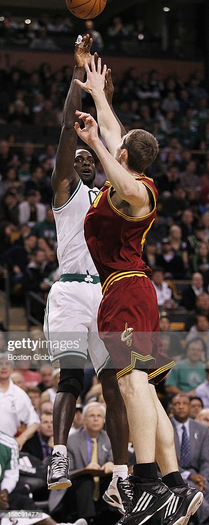 Celtics forward Kevin Garnett (#5) hits a fadeaway jumper of Cavaliers rookie center Tyler Zeller (#40) in the second quarter as the Boston Celtics play the Cleveland Cavaliers in a regular season NBA game at TD Garden in Boston, Mass. on Wednesday, December 19, 2012.
