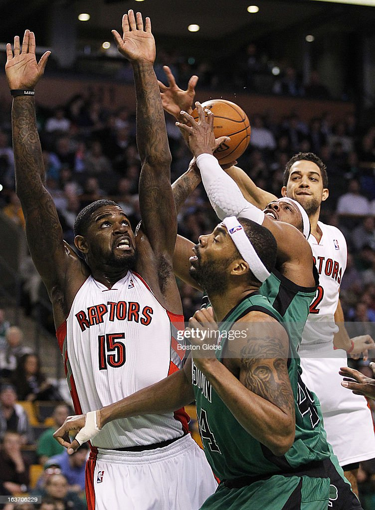 Celtics forward Paul Pierce (#34) drives through traffic in the first quarter with Raptors forward Landry Fields (#2) trailing him. Raptors forward Amir Johnson (#15) and Celtics forward Chris Wilcox (#44) are in the foreground. The Boston Celtics hosted the Toronto Raptors at the TD Garden during a regular season NBA game in Boston, Mass. on Wednesday, March 13, 2013.