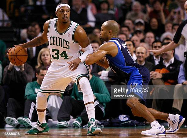 Celtics forward Paul Pierce posts up Mavericks guard Derek Fisher in the fourth quarter as the Boston Celtics play the Dallas Mavericks during a...
