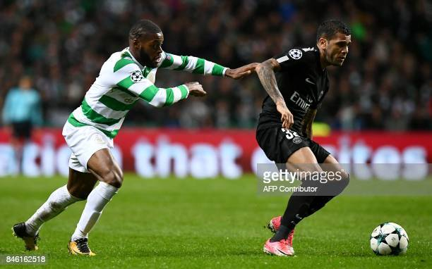 Celtic's French midfielder Olivier Ntcham tackles Paris SaintGermain's Brazilian defender Dani Alves during the UEFA Champions League Group B...