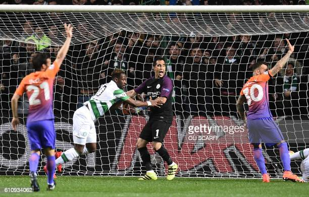 Celtic's French striker Moussa Dembele celebrates scoring his team's first goal during the UEFA Champions League Group C football match between...