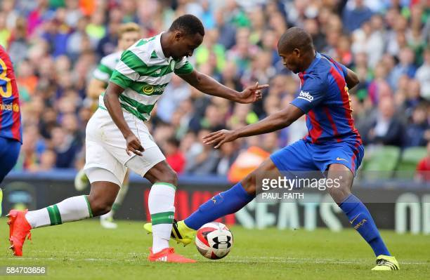 Celtic's French striker Moussa Dembele vies with Barcelona's Brazilian defender Marlon during the preseason International Champions Cup football...