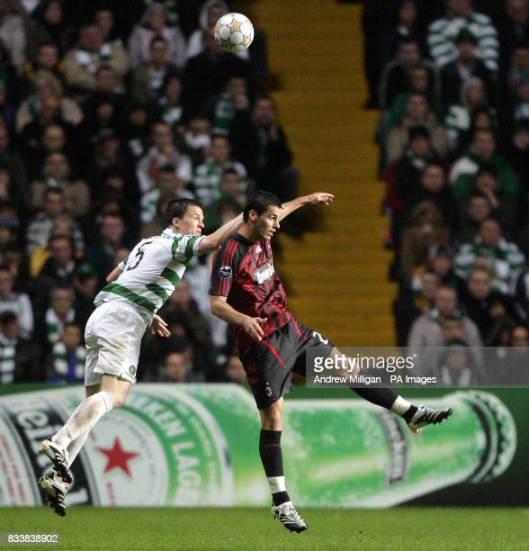 Celtic's Gary Caldwell and AC Milan's Yoann Gourcuff battle for the ball in the air