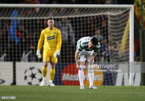 Celtic's Gary Caldwell and goalkeeper Artur Boruc stand dejected after Barcelona's Hernandez Xavi scores his sides first goal of the game