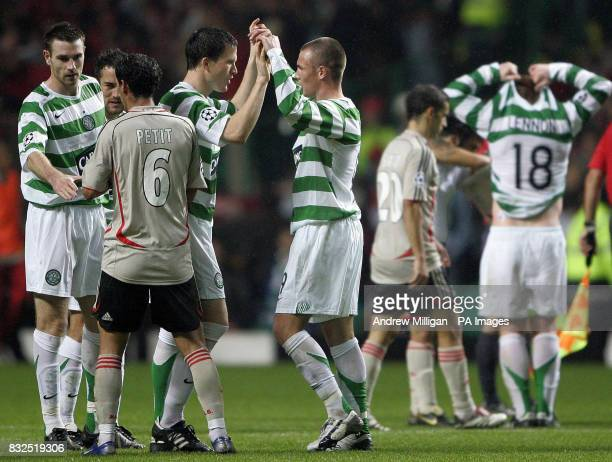 Celtic's Gary Caldwell celebrates with teammate Kenny Miller after defeating Benfica in the Champions League group F match at Celtic Park Glasgow