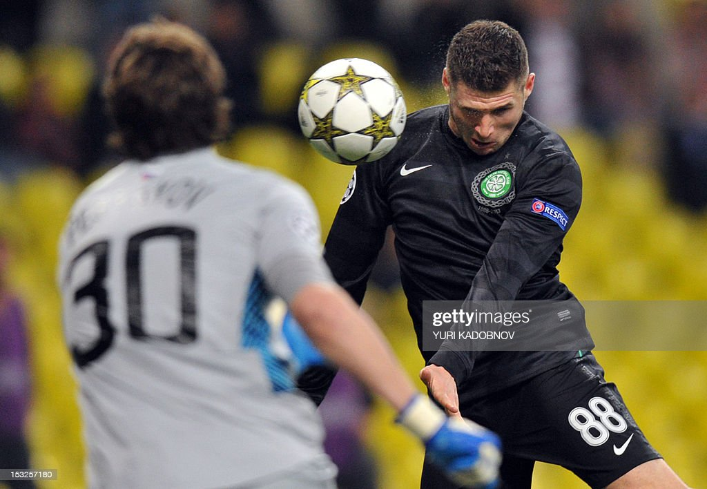 Celtic's Gary Hooper (R) heads as Spartak's Moskva goalie Sergei Pesyakov (L) tries to stop him during their UEFA Champions League group G football match at the Luzhniki stadium in Moscow on October 2, 2012.