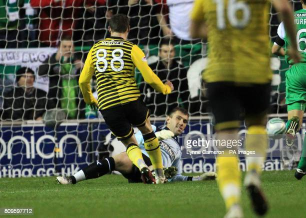 Celtic's Gary Hooper scores his sides fourth goal during the Scottish Communities League Cup Quarter Final at Easter Road Edinburgh