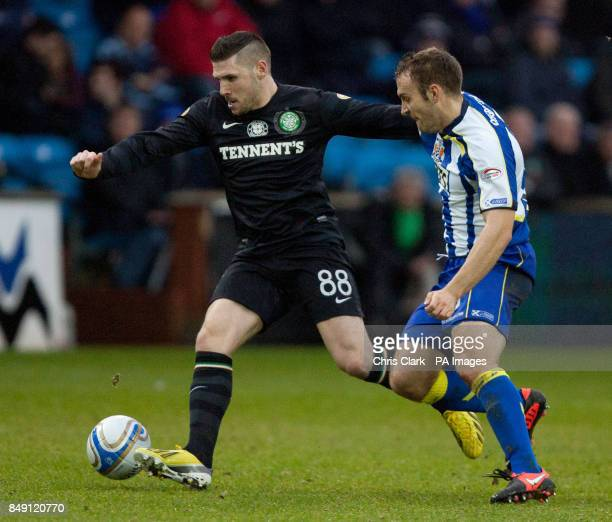 Celtic's Gary Hooper shields the ball from Kilmarnock's Liam Kelly during the Clydesdale Bank Scottish Premier League match at Rugby Park Kilmarnock
