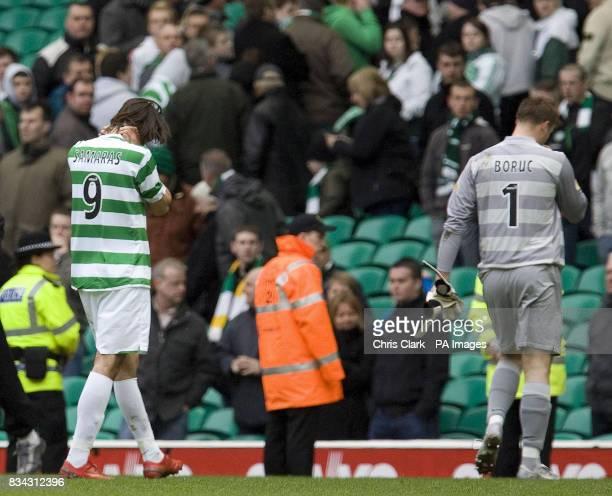 Celtic's Georgios Samaras and Artur Boruc leave the pitch dejected following the Clydesdale Bank Scottish Premier League match at Celtic Park Glasgow