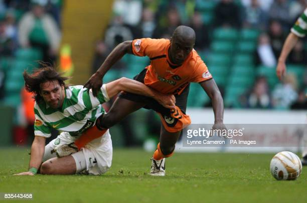 Celtic's Georgios Samaras and Dundee United's Morgaro Gomis battle for the ball during the Clydesdale Bank Scottish Premier League match at Celtic...