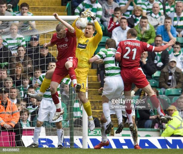 Celtic's goalkeeper Artur Boruc drops the ball during a challenge from Aberdeen's Zander Diamond during the Clydesdale Bank Premier League match at...