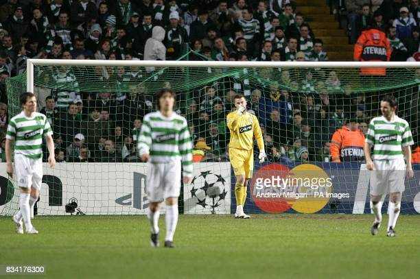Celtic's goalkeeper Artur Boruc stands dejected with his team mates after Barcelona's Thierry Henry scores the second goal