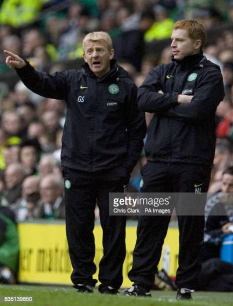 Celtic's Gordon Strachan and coach Neil Lennon watch during the Clydesdale Bank Scottish Premier League match at Celtic Park Glasgow